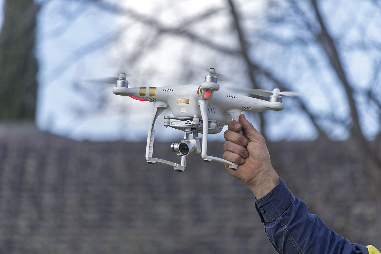Holding a drone up to show scale
