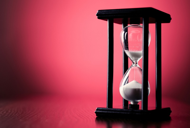 Hourglass on red background